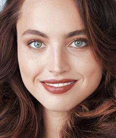 Choose a brown lipstick that's one or two tints darker than your natural lip color—it will warm up your complexion.