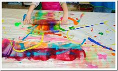Rolling pin paper--great preschool activity, perhaps as a precursor to art in the style of Eric Carle.  Or a less likely to be messy way to introduce Jackson Pollack.