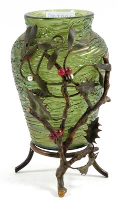 LOETZ VASE, thread-wound, iridescent green glass vase in a holly and mistletoe metal frame, 1900, H: 16 cm.