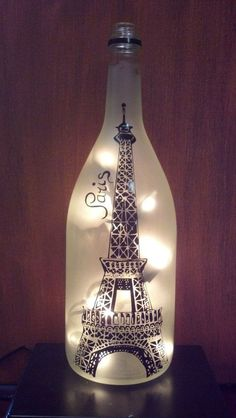 Eiffel Tower, Paris, Recycled Wine Bottle Lamp light This listing is for one Bottle Lamp with lights. This lamp is made out of a recycled wine bottle. The vinyl pictured is in black (other colors Old Wine Bottles, Recycled Wine Bottles, Wine Bottle Art, Wine Bottle Crafts, Bottles And Jars, Glass Bottles, Beer Bottle, Decorative Wine Bottles, Decorative Items