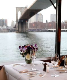 """The River Café (New York).  """"Ignore all the marriage proposals taking place around you: the real romance here is the iconic New York City view, looking out to the Brooklyn Bridge and Statue of Liberty. But unlike some view-focused restaurants, the American menu lives up to its iconic surroundings (and has a Michelin star to prove it), featuring stone crabs from Florida, chicken from the Pennsylvania Amish, beef from Nebraska, and foie gras from the Hudson Valley."""""""