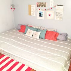 Everyone, I finally did it! One big a$$ bed for us the co-sleeping type . We are still going to add box springs (I love this way but the hubs isn't digging the hippie style...he's boring ). And also adding string of lights across the ceiling a wee bit. So who loves it??