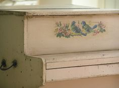 .... sweet little blue birds painted on piano...