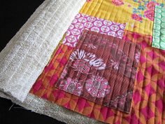 old towels used as batting for floor mat quilt