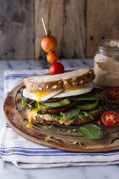 This is hands down the best BLT recipe out there! Bourbon caramelized bacon + heirloom tomato BLT with fried eggs and chipotle-bourbon mayo