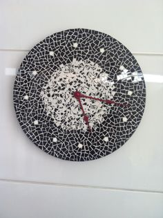 Black and white mosaic wall clock
