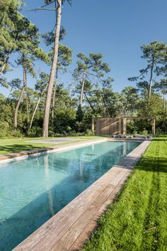 Looking out towards the pool from a house featuring a cedar-clad facade.