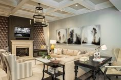 Cushioned walls flank the TV and fireplace in the living room