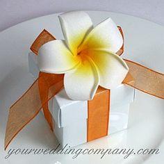 Foam frangipani (plumeria) flower wedding favor box design.  DIY handmade wedding favor idea via www.yourweddingcompany.com