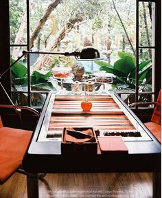 how totally fabbbb!!! ... a rock'n game table with a tropical view... & lil jars of tempting treats ~all within arms reach!