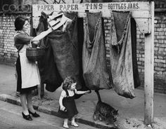 Recycling Household Waste in ca. 1943 - Due to shortages caused by the war, people are being encouraged to recycle their newspapers, tins and glass. | Location: Hornsey, London, England, UK.