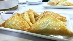 The salty cheese, combined with the buttery, crisp phyllo and a drizzle of sweet syrup over the top is truly unique.