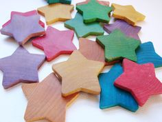 These cute and colorful stars are another addition to our learning Closet. These handheld manipulatives are great for transferring activities, counting, and color sorting and offer a myriad of open-ended play opportunities.    These Counting Stars have been hand painted with a nontoxic water based wash. They have been lightly sealed with a combination of organic beeswax and jojoba oil to keep the colors vibrant.    Each set comes with 18 stars in a drawstring pouch:  3 red  3 orange  3…