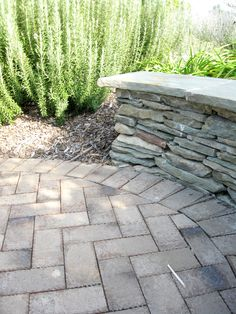 Herringbone Design Patio With Stacked Stone Wall