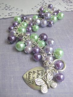 Another cute bracelet for bridesmaids - Cluster bracelet purple lilac mint green Butterfly by buysomelove, $18.50