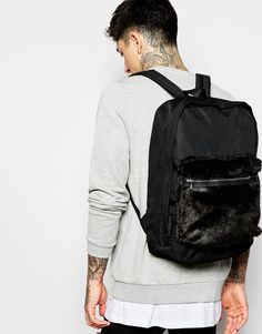 227421bcf815 Image 3 of ASOS Backpack In Black With Faux Fur Front Pocket College  Backpacks