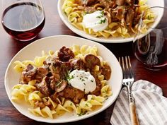 Beef Stroganoff over Buttered Noodles - made this with round steak, perfecto.