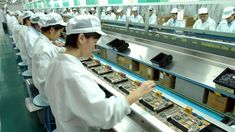 Workers on the factory line in an electronics factory in Shenzhen Photo: EPA