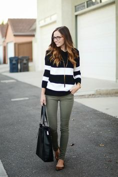Not sure what to pair with your olive toned skinnies this fall? Keep it simple with black & white stripes & a long pendant necklace.