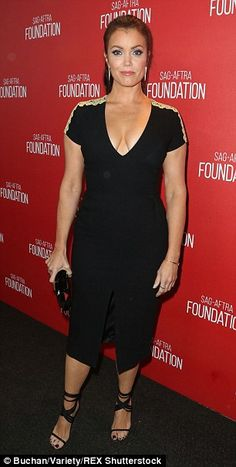 Flashy ladies: While Bellamy Young showed off cleavage, Virginia Madsen allowed an ample g...