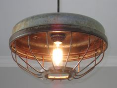 Need to go to my parents and get some old farm stuff.   Chicken Feeder Industrial Pendant Light- Vintage, Kitchen lighting, Industrial lighting, Farmhouse lighting by OutoftheWdworkDesign on Etsy https://www.etsy.com/listing/231202404/chicken-feeder-industrial-pendant-light