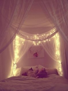 Stunning effect with the fairy lights and white fabric.