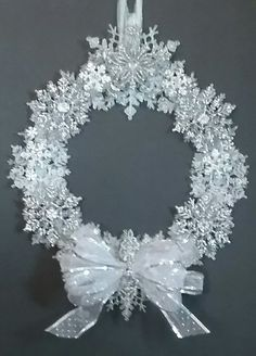 Christmas Snowflake Wreath Whimsical by GlitterGlassAndSass Christmas Swags, Christmas Snowflakes, Diy Christmas Ornaments, Holiday Wreaths, Christmas Holidays, Wreath Crafts, Christmas Projects, Christmas Crafts, Holiday Door Decorations