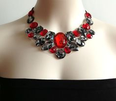 A personal favorite from my Etsy shop https://www.etsy.com/listing/153762968/bib-necklace-red-and-lacy-rhinestone