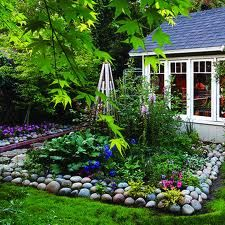 Stone border. I could so do this in my Glacier garden--oh I have--just not so neatly!