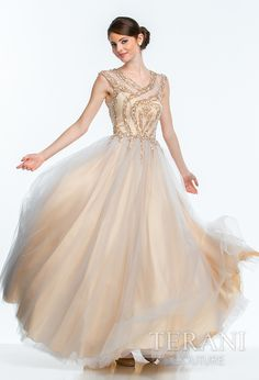Sleeveless tulle prom ballgown with nude illusion top embellished with sequins and stones in a linear design that is continued onto the high hip. the dress is finished with a full tulle skirt
