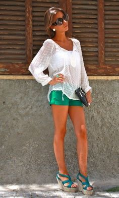 colored short, wedges and dressy top.