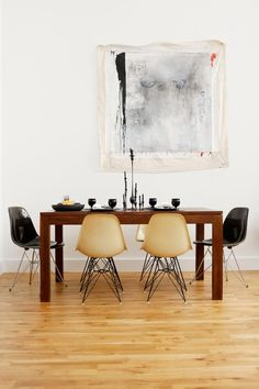 The Eames chairs are both new and old—the light-colored ones are vintage, the dark pair is from Design Within Reach.