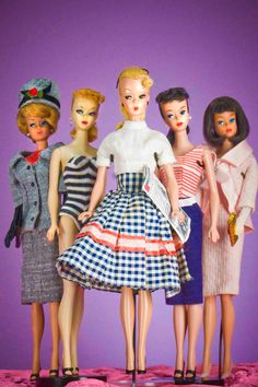 """Vintage Barbie...The Barbie on the far left is mine. She has a """"bubble cut"""" with beautiful red hair. And I still have her!"""
