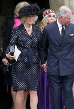 Prince Charles, Prince of Wales and Camilla, Duchess of Cornwall follow the coffin of Mark Shand as it leaves Holy Trinity Church in Stourpaine on May 1, 2014 near Blandford Forum in Dorset, England.
