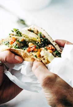 A vegan bend on the traditional sabich sandwich with white beans, harissa and tabbouleh. An awesome mega sandwich.