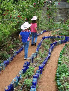 create a magical path with old bottles - this is so pretty!  Drink up :)