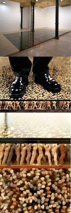 'Epic Floor' of little statues holding it up - installation.