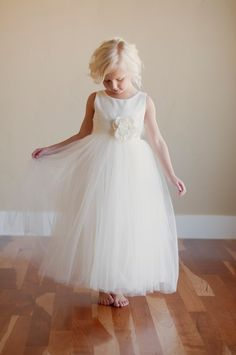 The Sorrell Dress: Silk Flower Girl Dress with 6 layer, lined tulle skirt  and a lace flower belt. $140.00, via Etsy.
