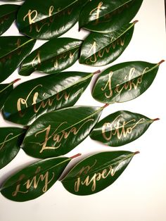 Gold ink calligraphy on leaf place cards.