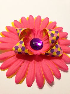 I.M. Pink and Sassy Collection - Pink and yellow daisy with purple bling.  With a soft felt back and a Velcro tie, this pet bow is comfortable and stylish.  Buy this bow for your pet and help a pet rescue organization at the same time.  Please visit it us at https://www.facebook.com/pages/Isabellas-Pet-Shop   Thank you  and please share our pin and cause with your family and friends.