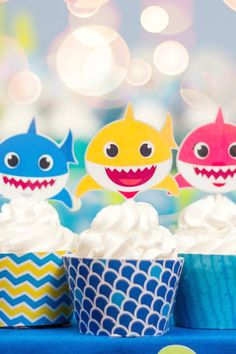 You don't have to be an experienced baker to create some show-stopping cupcakes. Simply buy some at your local store or bake a batch. Top them with these cute Baby Shark toppers and place them in these cool wrappers and you're good to go. Now, how easy is that?! See more party ideas and share yours at CatchMyParty.com #catchmyparty #partyideas #babyshark #babysharkparty #babysharkpartysupplies #babysharkcupcakes