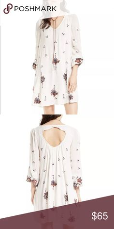 Free People Embroidered Minidress | XS free people embroidered minidress | new without tags | make a flirtatious entrance in a breezy minidress embellished with colorful embroidery | slips on over head | v-neck | long sleeves | lined | 100% viscose Free People Dresses Mini