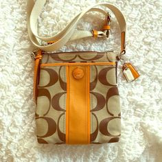 COACH NWOT Cross Body Satchel Sturdy strap adjusts for over shoulder wear as well. This bag is perfect for everyday, shopping, and especially vacations. Lays flat to body for a more streamlined look and will hold all your essentials. Coach Bags