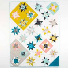 FaveQuilts has put together its very first free eBook of free quilt patterns! The 12 Awesome Free Quilt Patterns and Small Quilted Projects eBook has over 50 pages filled with applique quilt patterns, patchwork quilts, and small quilted projects. Star Quilt Blocks, Star Quilt Patterns, Modern Quilt Patterns, Modern Quilting, Sampler Quilts, Lap Quilts, Heart Quilts, Bright Quilts, Fat Quarter Quilt