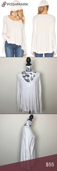 """NWOT FREE PEOPLE MALIBU WAFFLE THERMAL TEE IVORY NWOT WE THE FREE MALIBU WAFFLE THERMAL TEE IVORY  Contrast rib knit fabric panel inserts. Thumbhole  95% rayon, 5% spandex  Length 26"""" in front, 29"""" in back. Bust 20.5"""" Free People Tops Tees - Long Sleeve"""