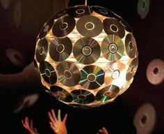 Up-cycle some old CD's to create a disco ball. Up-cycle some old CD's to create a disco ball. Cd Diy, Recycled Cds, Recycled Crafts, Cd Crafts, Crafts With Cds, Craft Projects, Recycling, Crafty, Holiday Decor