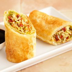 Mediterranean Spring Rolls These flaky, restaurant-quality spring rolls are filled with a deliciously different filling of sun-dried tomatoes and artichoke hearts. Oven baked instead of fried, these sophisticated appetizers are irresistible! Empanadas, Great Recipes, Favorite Recipes, Amazing Recipes, Delicious Recipes, Recipe Ideas, Pepperidge Farm Puff Pastry, Good Food, Yummy Food