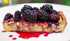 Puffy corn pancake with blackberry sauce. Photo: Andrew Scrivani for The New York Times