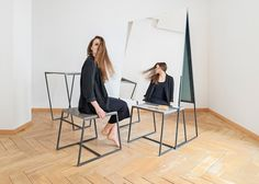 Minimally designed hairdressers in Zurich featuring freestanding mirrors and furniture.