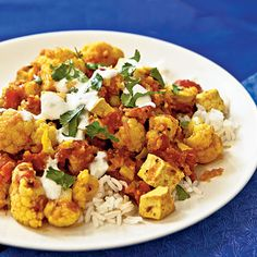 This is a riff on the Indian dish aloo gobi, with tofu standing in for traditional potatoes.